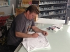 Chip Foose Draws on a TBP shirt for the Tom's Bronco Parts Crew
